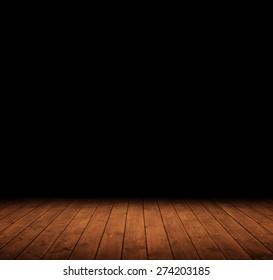 wooden interior room leading into the dark.