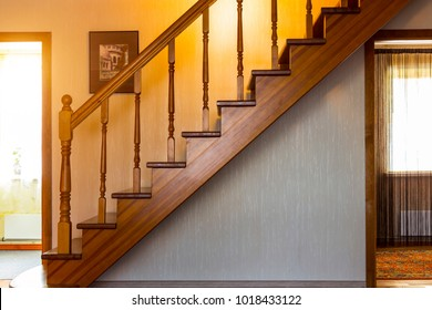 Wooden interior staircase to the second floor.