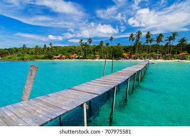 Wooden jetty to the beautiful sea, Koh Kood (Ko Kut), Trat Province, Thailand.