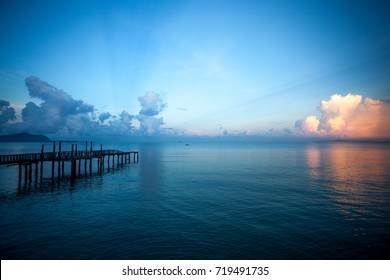Wooden jetty with beautiful sunset dramatic sky