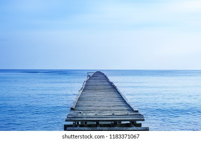 wooden jetty with blue sky background. selective focus.