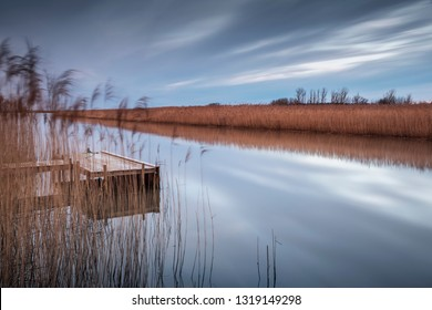 Wooden jetty by lake. Utvalinge, Sweden.