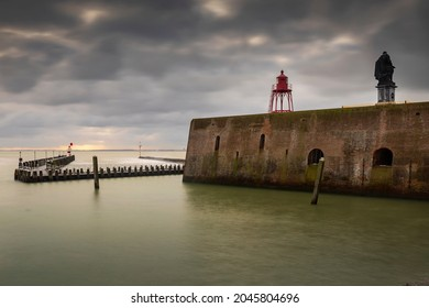 wooden jetty at the entrance of the harbour of Vlissingen with on the right the statue of naval hero Michiel de Ruyter from 1841 by the Flemish sculptor Louis Royer; Vlissingen, Netherlands