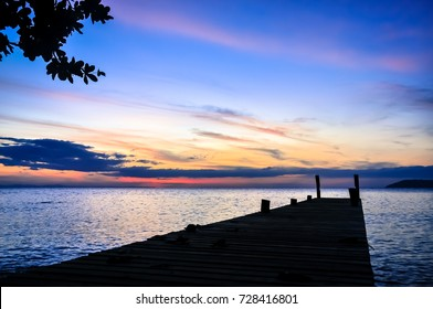 wooden jetty go to sea before sunrise with colerful sky