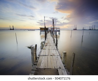 Wooden Jetty House With Background of Vibrant Sunrise in Tanjung Langsat, Johor, Malaysia