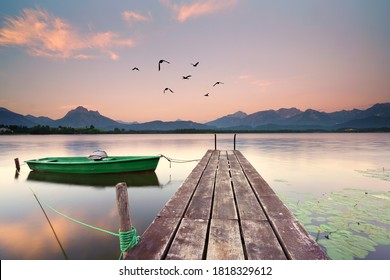 wooden jetty at the lake, boat on the lake