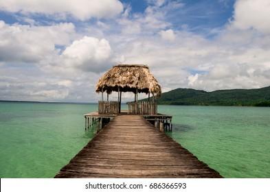 A wooden jetty at Petén Itzá lake. Guatemala