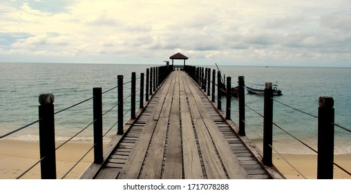 wooden jetty on a beach