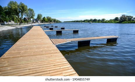 Wooden jetty over the river on a beautiful hot day