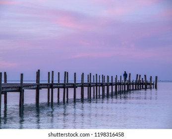 A wooden jetty reaches out to sea on Ao Phrao beach on Koh Kood or Ko Kut island in eastern Thailand