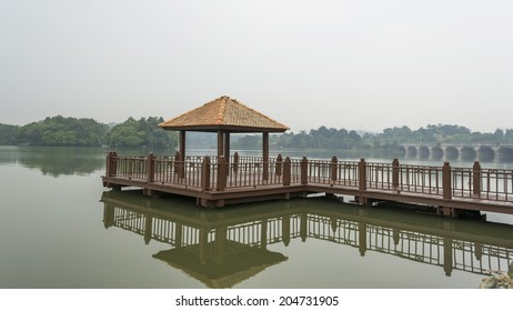 Wooden jetty with reflection in morning mist