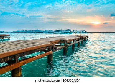 Wooden jetty with sunset background.