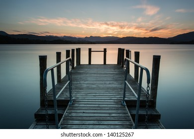 Wooden jetty at sunset, Lake Windermere in the English Lake District