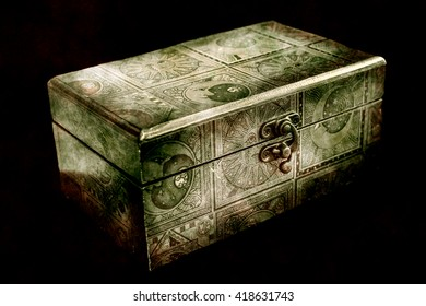 Wooden jewelry box isolated on black background, HDR processing in old shade.