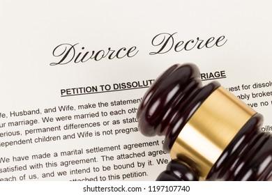 Wooden judge gavel and divorce decree; document is mock-up