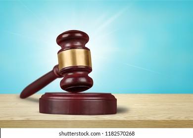 Wooden judge gavel on blurred background close-up
