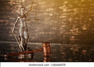 Wooden judge gavel on blurred background close-up