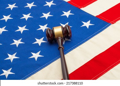 Wooden judge gavel over USA flag - closeup shoot