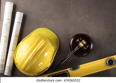 wooden judge gavel with protective helmet. Construction and labor law concept.