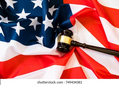 Wooden judge gavel and soundboard laying over US flag. Hammer and gavel. American law and justice concept. bidding concept.