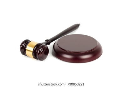 Wooden judge gavel and soundboard on white background