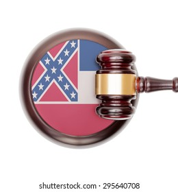 Wooden judge gavel with USA state flag on sound block - Mississippi