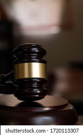Wooden judge gavel, vertical and close-up view.