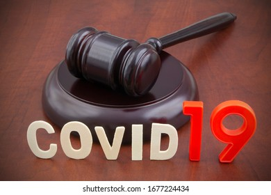Wooden judge gavel with word covid19. Concept of laws and decisions against covid-19.