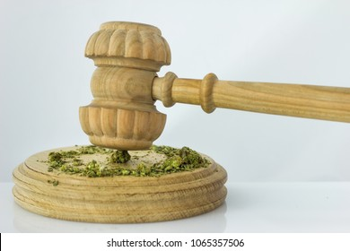Wooden judge hammer with sound block on the white mirror background - Legality of cannabis, legal and illegal cannabis on the world.