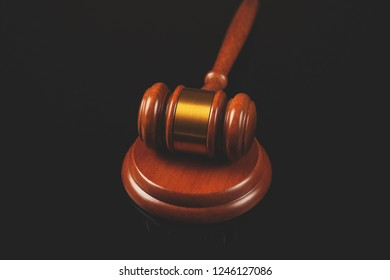 Wooden judge on the black table background