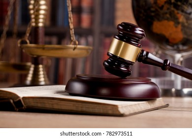 Wooden Judges gavel ,golden scales justice. Law concept