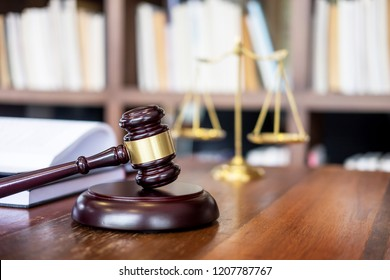 Wooden judges gavel on wooden table on light background, justice Law concept close up in a courtroom or enforcement office
