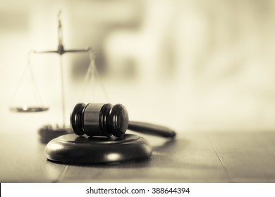 Wooden judges gavel on wooden table, close up. Retro stylization