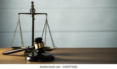 Wooden judge`s gavel.  Themis figurine. The criminal law. Low concept.