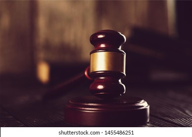 Wooden justice hammer closeup on dark background