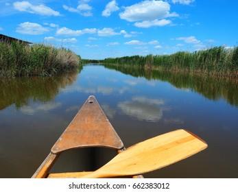 Wooden kayak with paddle on Neusiedler See, Lake Neusiedl. Rust, Burgenland, Austria.