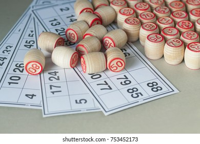 Wooden kegs and cards for a game in a lotto.