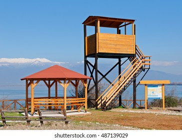 Wooden kiosk, watchtower and informative billboard at protected wetland site