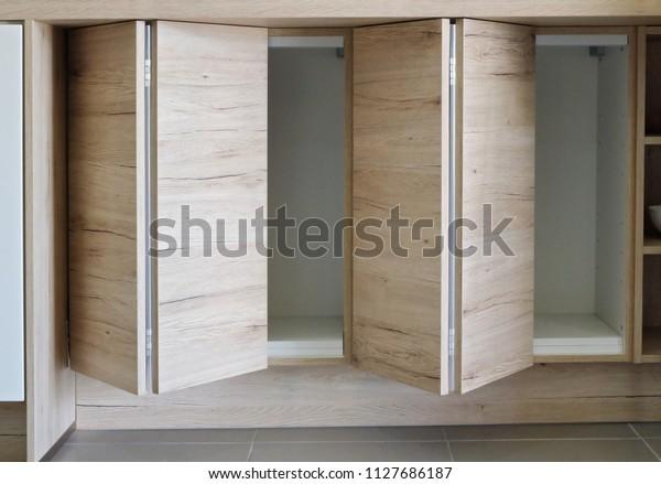 Wooden Kitchen Cabinet Storage Folding Door Stock Photo Edit Now 1127686187