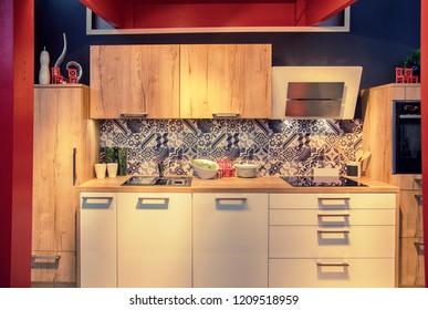 wooden kitchen with decorative tiles