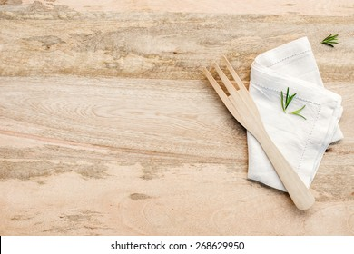 Wooden kitchen table from above with copy space. rosemary on wood table. kitchen photo for recipe book or advertisement.