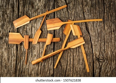 Wooden kitchen utensils on rustic background close-up. Flat lay.