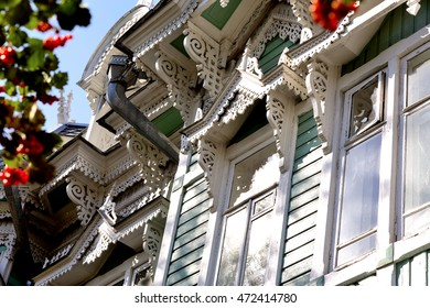 Wooden lace of an old house architecture. Carvings in wood. House turquoise color. White patterns. Year built: one thousand nine hundred and four. Tomsk, Siberia, Russia.