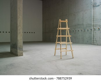 wooden ladder in the empty space with concrete wall
