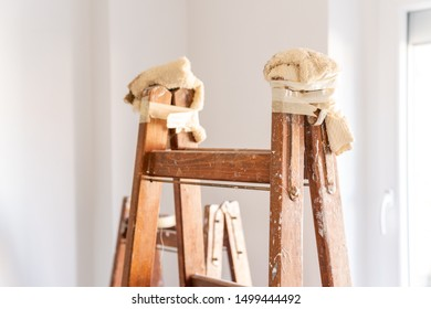 Wooden ladder stands ready for renovation in the house