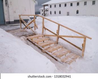 Wooden ladder at winter season