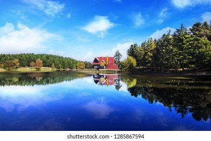 Wooden Lake house inside forest in Bolu Golcuk National Park, Bolu