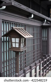 Wooden lamp in front of japanese house