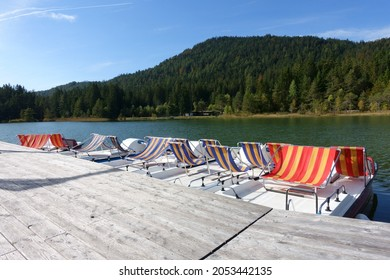 Wooden landing place for paddleboats at lake Wildsee in Seefeld, Tyrol, Austria in early autumn