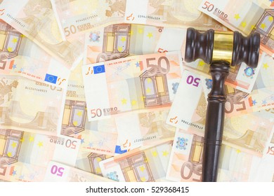 Wooden Law Gavel and Euro Money Banknotes background